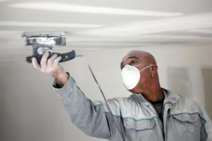 this picture shows ceiling asbestos removal in phoenix